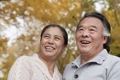 foto of 55-60 years old  - Old couple in park - JPG