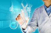 picture of gene  - Woman scientist touching DNA molecule image at media screen - JPG