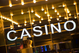 pic of poker machine  - Casino entrance at evening time - JPG