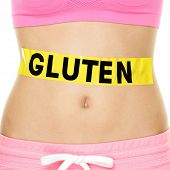 Постер, плакат: Gluten allergy health and Celiac disease and digestion concept with GLUTEN text written on stomach