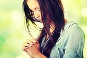 pic of sinful  - Closeup portrait of a young caucasian woman praying - JPG
