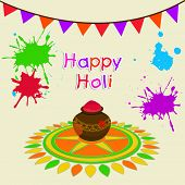 Indian festival Happy Holi celebrations concept with beautiful traditional mud pot with full of colo