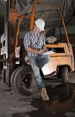 picture of heavy equipment operator  - Young construction worker and forklift operator  on site - JPG