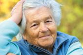 stock photo of senior-citizen  - Portrait of an elderly woman leaning on hand - JPG