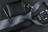 Постер, плакат: Tie Belt Wallet Cufflinks Pen Lying On The Skin