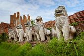 Stone Lions In The Ruins Of An Ancient Temple. Thailand, Ayuthaya