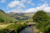 stock photo of dungeon  - Beautiful Lake District river Mickleden Beck Langdale Valley by Old Dungeon Ghyll Cumbria England United Kingdom UK by campsite - JPG