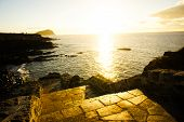 foto of canary  - Sunrise on a Pier over Atlantic Ocean in Tenerife Canary Islands Spain - JPG