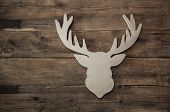 picture of antlers  - Vintage rustic christmas decoration with antler on wooden brown background - JPG