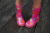 image of shy girl  - Cute little girl legs in rubber boots  - JPG