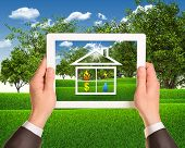 picture of public housing  - Hands hold tablet pc with symbols of public service and house - JPG