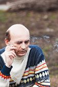 stock photo of exhale  - The man exhales the smoke from cigarettes