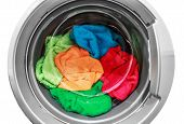 picture of washing machine  - colorful clothes in the washing machine on a white background - JPG