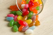 picture of jelly beans  - Jelly beans in a glass on wooden board