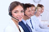 picture of telemarketing  - Attractive  positive young businesspeople and colleagues in a call center office - JPG