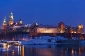 foto of winter palace  - View of the Wawel castle and the Vistula River in Krakow in winter night - JPG
