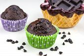 stock photo of chocolate muffin  - Close up of chocolate muffins on a white table with a lot of chocolate - JPG