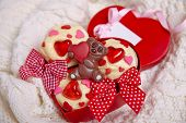 image of red velvet cake  - Red velvet cupcakes decorated with hearts for Valentines day - JPG