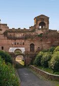 stock photo of fortified wall  - The Porta Asinaria is a gate in the Aurelian Walls of Rome - JPG