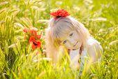 stock photo of poppy flower  - Little girl  - JPG