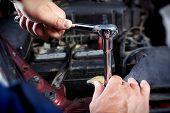 foto of garage  - Mechanic working in auto repair garage - JPG