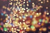 picture of glow  - Festive background with natural bokeh and bright golden lights - JPG