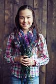 picture of wildflowers  - Cute girl holding bunch of wildflowers - JPG