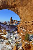 picture of arch  - Turret Arch seen through North Window Arch in Arches National Park Utah in winter - JPG