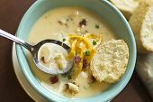 picture of scallion  - Creamy loaded baked potato soup with scallion garnished and fresh Italian bread - JPG