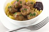 stock photo of meatball  - Swedish meatballs in creamy gravy with curly egg noodles and grape jelly - JPG