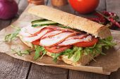 stock photo of rocket salad  - Submarine sandwich with smoked ham - JPG