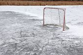 stock photo of ponds  - A ice hockey net on an outdoor pond rink - JPG