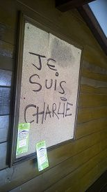 stock photo of bus-shelter  - Je Suis Charlie written on a notice board in a bus shelter in southern france - JPG