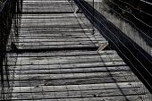 image of suspension  - Broken boards on old walkway suspension bridge - JPG