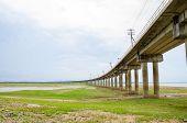 stock photo of dam  - Railroad tracks into the reservoir Pa Sak Jolasid Dam Lopburi Thailand - JPG