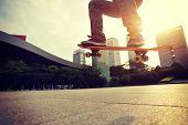 image of skateboarding  - skateboarder doing skateboarding trick ollie on city - JPG