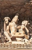 stock photo of kamasutra  - Stone carved erotic sculptures on Javari Temple - JPG