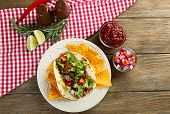 picture of tacos  - Mexican food Taco in plate on wooden table - JPG