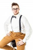 foto of braces  - a handsome young man or hipster with braces and a bow tie isolated over a white background - JPG