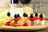 picture of canapes  - Cheese canapes with wine on table close up - JPG