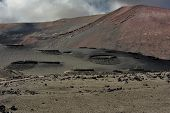 stock photo of canary-islands  - wild volcanic landscape at Timanfaya National Park Lanzarote Island Canary Islands Spain - JPG