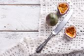 picture of passion fruit  - Passion fruits on color wooden background - JPG