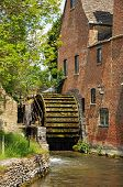 stock photo of slaughter  - The Old Mill along the river Eye Lower Slaughter Cotswolds Gloucestershire England UK Western Europe. ** Note: Visible grain at 100%, best at smaller sizes - JPG