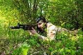 foto of rifle  - Bearded soldier with a rifle in the woods - JPG