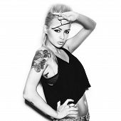image of swag  - Stylish fashionable blonde girl hipster with tattoo in black clothes - JPG