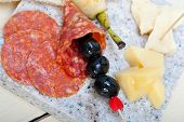 foto of salami  - cold cut assortment cheese salami and fresh pears served on a granite stone - JPG