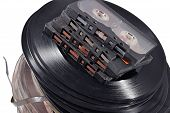 picture of magnetic tape  - Old vintage bobbins vinyl records and cassette tapes on a white background - JPG