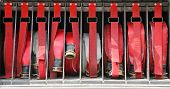 pic of fire brigade  - red water pipes of firemen to fire off - JPG