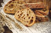 stock photo of fresh slice bread  - Sliced fresh handmade bread on a white tablecloth - JPG