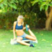 pic of step aerobics  - Young woman during her outdoor step workout - JPG